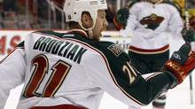 Minnesota Wild center Kyle Brodziak celebrates his goal against the Phoenix Coyotes in the first period of an NHL hockey game, Saturday, Dec. 10, 2011, in Glendale, Ariz. (AP Photo/Paul Connors) (PAUL CONNORS)