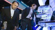 Ambrish Srivastava (L) and Daniel Rusbarsky of BMO Capital Markets look over Toshiba laptop computers in a Microsoft booth during the first day of the 2011 International Consumer Electronics Show (CES) in Las Vegas, Nevada January 6, 2011. The computers were showing glassless (no glasses required) 3D displays. (STEVE MARCUS/REUTERS)