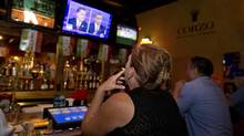 Sophia Peranteau watches the presidential debate at a Las Vegas restaurant on Oct. 22, 2012. (Julie Jacobson/Associated Press)