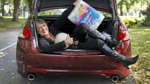 Barbara Budd makes maximum use of her Acura's large trunk space.