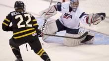Team Canada forward Hayley Wickenheiser pressures Team USA goalie Jessie Vetter (Adrian Wyld/THE CANADIAN PRESS)