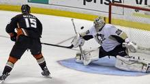 Anaheim Ducks center Ryan Getzlaf (15) misses wide of the goal against Pittsburgh Penguins goalie Marc-Andre Fleury (29) in a shootout in an NHL game in Anaheim, Calif., Friday, March 7, 2014. (Reed Saxon/AP)