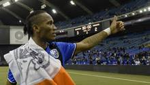 Montreal Impact forward Didier Drogba (11) interacts with fans after the first leg game against the Toronto FC of the MLS Eastern Conference Championship at Olympic Stadium. (Eric Bolte)
