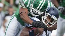 Toronto Argonauts quarterback Steven Jyles is tackled by Saskatchewan Roughriders linebacker Jerrell Freeman during the second quarter CFL football action at Mosaic Stadium on Saturday, September 17, 2011 in Regina. THE CANADIAN PRESS/Liam Richards (Liam Richards/CP)