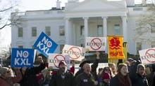 Demonstrators stand in front of the White House in Washington during a rally in support of President Barack Obama's pledge to veto any legislation approving the Keystone XL pipeline. (Jose Luis Magana/AP)