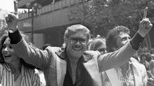 FILE - In this May 19, 1980 file photo, Los Angeles Lakers owner Jerry Buss gestures as the NBA championship team is honored with a parade in Los Angeles. (Associated Press)