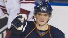 Edmonton Oilers' Denis Grebeshkov, of Russia, celebrates his first goal in the NHL on the Phoenix Coyotes during the second period of NHL hockey action at Edmonton's Rexall Place on Thursday, January 10, 2008. (John Ulan/The Canadian Press)
