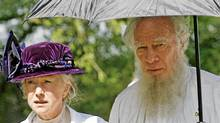 British actress Helen Mirren and Canadian actor Christopher Plummer walk aroud the set of the film 'The Last Station' currently been filmed in the eastern German town of Pretzsch om May 14, 2008. The film is a historical drama that illustrates Russian author Leo Tolstoy's struggle to balance fame and wealth with his commitment to a life devoid of material things. (SEBASTIAN WILLNOW)