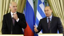 Russian Prime Minister Vladimir Putin, right, and Greek Prime Minister George Papandreou seen at a news conference in Moscow, Tuesday, Feb. 16, 2010. (Misha Japaridze)