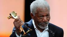 "US actor Morgan Freeman holds his trophy in the category ""International Lifetime Achievement"" during the 47th Golden Camera award ceremony in Berlin, Feb. 4, 2012. (Maurizio Gambarini/Maurizio Gambarini / AP)"