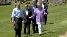 Group of Eight leaders walk out for the family photo at the summit May 19, 2012 in Camp David, MD. (Paul Chiasson/THE CANADIAN PRESS)