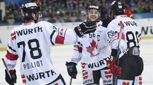 Canada's Maxim Noreau celebrates after scoring against HK Dinamo Minsk at the 90th Spengler Cup ice hockey tournament in Davos, Switzerland, on Friday, Dec. 30, 2016. (Melanie Duchene/AP)