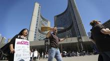 A file photo shows striking civic workers picketing outside Toronto City Hall in June 2009. (Kevin Van Paassen/The Globe and Mail/Kevin Van Paassen/The Globe and Mail)