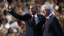 President Barack Obama waves after former President Bill Clinton addressed the Democratic National Convention in Charlotte, N.C., Wednesday, Sept. 5, 2012. (David Goldman/AP)