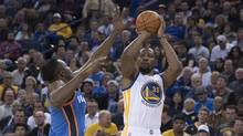 Golden State Warriors forward Kevin Durant shoots the basketball against Oklahoma City Thunder forward Jerami Grant during the fourth quarter at Oracle Arena. (Kyle Terada/USA Today Sports)