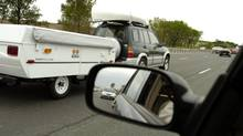 Another long weekend, another long, slow drive up to the cottage for these drivers on Hwy 400. (Fred Lum/The Globe and Mail)
