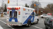 Paramedics from Toronto Emergency Medical Service carry a patient from a collision at Pape Ave. and O'Connor St., Toronto December 19, 2011. (Fernando Morales/Fernando Morales/The Globe and Mail)