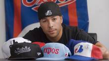 Montreal Expos' fan Annakin Slayd poses for a photograph at his apartment in Montreal, Tuesday, August 14, 2012. (The Canadian Press)