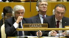 Canada's Foreign Minister Lawrence Cannon, bottom left, after the first United Nations vote on the election of the five non-permanent members of the Security Council October 12, 2010 at the United Nations in New York.