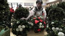 A worker arranges preserved flowers and foliage at the Vermont Flowers export processing zone factory in Nairobi, in a file photo. Kenya is the European Union's biggest supplier of cut flowers. (THOMAS MUKOYA/REUTERS)