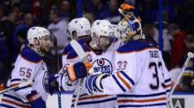 Edmonton Oilers right wing Iiro Pakarinen (26) celebrates with goalie Cam Talbot (33) after defeating the St. Louis Blues 2-1 at Scottrade Center, in St. Louis, on Feb. 28, 2017. (Jeff Curry/USA Today Sports)