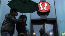Pedestrians walk past a Lululemon Athletica store in New York, March 19, 2013. The Taiwanese supplier behind the see-through yoga pants recalled by Lululemon Athletica Inc said on Tuesday it followed design specifications and the Canadian retailer had merely misjudged customer tastes. (LUCAS JACKSON/REUTERS)