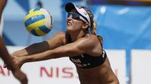 Canada's Heather Bansley sets the ball in a women's beach volleyball quarterfinal match against Brazil at the Pan American Games in Puerto Vallarta, Mexico, Wednesday Oct. 19, 2011. (Ariana Cubillos/AP/Ariana Cubillos/AP)