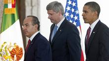 Prime Minister Stephen Harper makes his way to a joint news conference with Mexican President Felipe Calderon and U.S. President Barack Obama after the North American Leaders Summit on Aug.10, 2009, in Guadalajara. (Adrian Wyld/The Canadian Press)