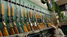 Hunting rifles and shotguns sit on the racks at a Toronto gun shop in December of 2002. (KEVIN FRAYER)