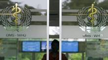 A person is seen approaching the main entrance of the World Health Organization headquarters in Geneva, Switzerland. (SALVATORE DI NOLFI)