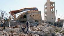 "A picture shows the rubble of a hospital supported by Doctors Without Borders (MSF) near Maaret al-Numan, in Syria's northern province of Idlib, on February 15, 2016, after the building was hit by suspected Russian air strikes. MSF confirmed in a statement that a hospital supported by the aid group in Idlib province was ""destroyed in air strikes"". (STRINGER/AFP/Getty Images)"