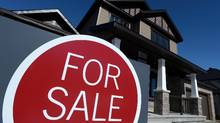 A sign advertises a new home for sale in Carleton Place, Ont., on March 17, 2015. New federal rules for Canadian mortgages have now gone into effect. The changes affect properties that cost more than $500,000 â a small percentage of the overall market. (Sean Kilpatrick/THE CANADIAN PRESS)