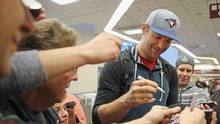 John Scott of the St. John's IceCaps signs autographs for fans on arrival at the Nashville International Airport on January 28, 2016 in Nashville, Tennessee. (Bruce Bennett/Getty Images)