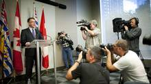 Adrian Dix surrounded by news cameras announces his resignation as leader of the BC NDP in Vancouver, British Columbia, Wednesday, September 18, 2013. (Rafal Gerszak For The Globe and Mail)