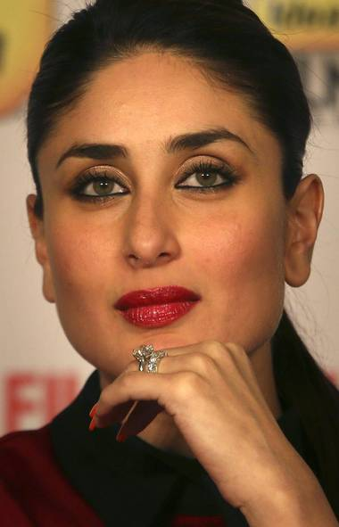 Indian Bollywood actress Kareena Kapoor listens to a question during a press conference in New Delhi, India, Tuesday, Dec. 18, 2012. (Manish Swarup/AP)