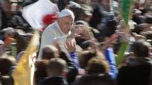 Pope Francis greets the crowd as he arrives for his weekly general audience in St. Peter's Square at the Vatican, March 5, 2014. (ALESSANDRA TARANTINO/AP)