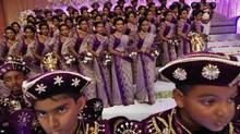 With 126 bridesmaids at their wedding, a Sri Lankan couple earns a Guinness World Record in Colombo. (Eranga Jayawardena/Associated Press)