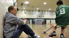Juha Mikkola, owner of FloorBallPro, watches game action at Crescent school in Toronto, May 7 , 2010. (J.P. MOCZULSKI)