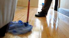 A cleaning woman works at the home of one of her clients. (Fred Lum/Fred Lum/THE GLOBE AND MAIL)