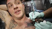 British actor Tom Hardy gets tattooed at Dark Day Studios in Vancouver this week. (The Globe and Mail)