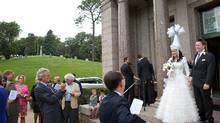 In a July 19, 2014 photo, Oliver Bonham-Carter and Janyl Jumadinova leave the chapel after their wedding ceremony at at Forest Lawn Cemetery in Omaha, Neb. the bride is from Kyrgyzstan and holds a firm belief in spirits. Some of the groom's ancestors are buried in the cemetery. The couple married earlier this year in a small ceremony in Pennsylvania, but wanted to hold another ceremony so friends and family could bear witness. (Matt Miller/AP Photo/The Omaha World-Herald)
