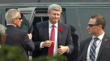 Canadian Prime Minister Stephen Harper (C) disembarks from a vehicle as he arrives to visit the historic Taj Mahal in the northern Indian city of Agra November 5, 2012. (Stringer/India/Reuters)