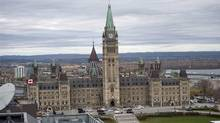 Centre Block on Parliament Hill in Ottawa is surrounded by police vehicles on on Wednesday, Oct. 22, 2014. A gunman opened fire at the National War Memorial, wounding a soldier, then moved to nearby Parliament Hill and wounded a security guard before he was shot, reportedly by Parliament's sergeant-at-arms. THE CANADIAN PRESS/Justin Tang