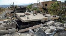 In this photo released by the Syrian official news agency SANA, damaged buildings wrecked by an Israeli airstrike are seen in Damascus on Sunday, May 5, 2013. (AP/SANA)