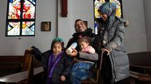 The Dalaa family at St. Joseph's College in Edmonton, Alberta on Sunday, December 27, 2015. The newly arrived refugees are being sponsored by a group through St. Josephs. Left to right is Karima Dalaa, 3, Iwan Dalaa, Ayat Dalaa, 1, and Zamzam Dalaa. Canada is on the cusp of receiving another surge of Syrians in order to meet its ambitious refugee admissions target by the end of 2016. (Amber Bracken For The Globe and Mail)