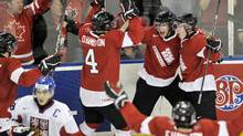 Canada forward Ryan Strome, back centre, celebrates his goal with teammates as Czech Republic forward Tomas Nosek, bottom left, skates on during second period IIHF World Junior Championships hockey action in Edmonton, on Wednesday, Dec. 28, 2011. (Nathan Denette/THE CANADIAN PRESS)
