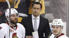 Ottawa Senators head coach Guy Boucher, center, stands behind Viktor Stalberg and Tommy Wingels on the bench during the third period of Game 5 of the Eastern Conference final. (Gene J. Puskar/AP)
