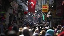 People fill an open market in the historic Sultanahmet district of Istanbul. Times have been hard for Turkey, buffeted by bombings, violence between government forces and Kurdish rebels, refugee flows from the war in neighbouring Syria and a failed coup attempt that unleashed a huge crackdown under an ongoing state of emergency. On April 16, 2017, Turks will decide whether to make the post of president more powerful in a constitutional referendum that is a big gamble for tough-talking president Recep Tayyip Erdogan. (Lefteris Pitarakis/AP)