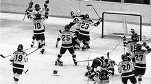 "In this Feb. 22, 1980, file photo, The United States ice hockey team rushes toward goalie Jim Craig after their 4-3 upset win over the Soviet Union in the semi-final round of the XIII Winter Olympic Games in Lake Placid, N.Y., The American players from left are, Mark Johnson (10); Eric Strobel (19); William Schneider (25); David Christian (23); Mark Wells (15); Steve Cristoff (11); Bob Suter (20), Philip Verchota (27). John O'Callahan is hugged by Michael Ramsey. Although Mark Johnson is sitting on the mother of all hockey motivational stories, he's waiting until just the right moment to break it out for the U.S. women's team. Johnson was the reason for the ""Miracle on Ice"" 30 years ago, scoring two goals for the U.S. hockey team when they toppled the Soviets. (1980 AP)"