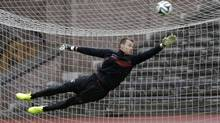 Belgium's soccer team goalkeeper Simon Mignolet tries to reach for a ball during training session at the squad's camp ahead of the World Cup in Stockholm May 30, 2014. (Reuters)